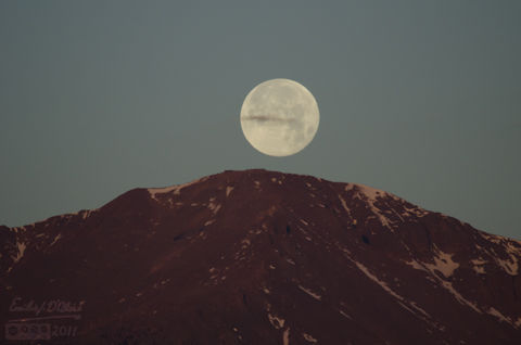 Moon about to set behind Pikes Peak