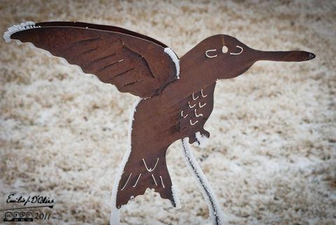 Metal lawn ornament frozen in time