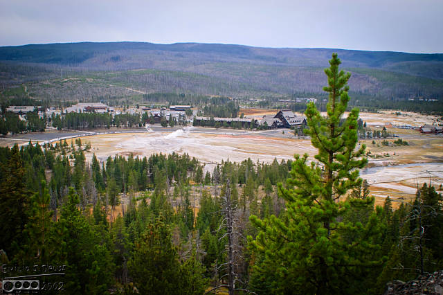 "Overlooking the Old Faithful area (OF itself is ""smoking"" in the wide-open area"