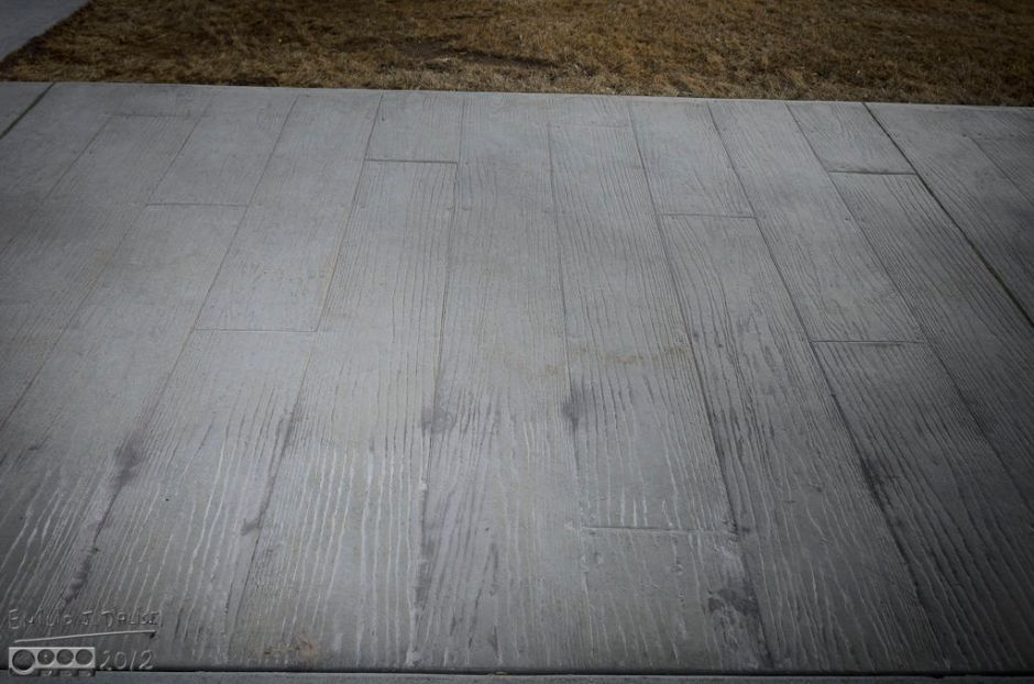 The cement is imprinted with the pattern of an old-time wooden sidewalk.