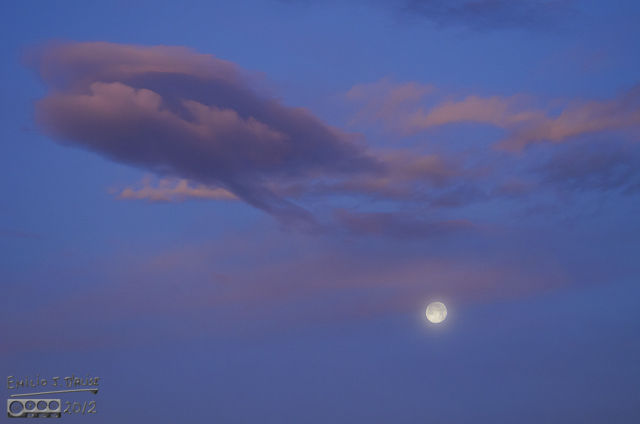 The moon is slightly veiled by the foreground clouds, but I thought that made it interesting.
