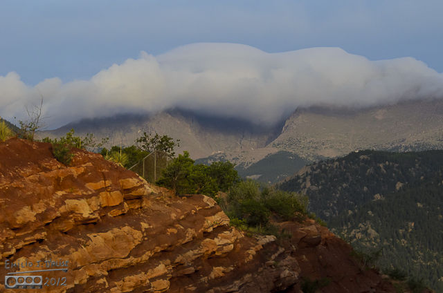 Just before heading up Ute Pass I stopped to capture one more shot of the cotton-cloud sheltering the top of Pikes Peak from the morning sun.