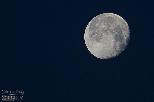 These kind of shots are only possible when the moon is low in the horizon, and the air is fairly still and clear.