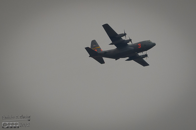 4:06 p.m. - Heading south along Roller Coaster Road, I stop to take a picture of one of the three C-130 assigned to fighting the fire.  At least I presumed that's what it was.