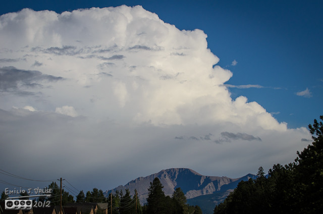 Not much can dwarf Pikes Peak, but a big-ass cloud can make it look puny.