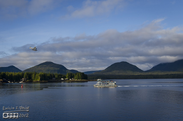 That's the same plane, and what looks like a small cruise boat.  Might be a ferry, but it looks more like a cruise boat.