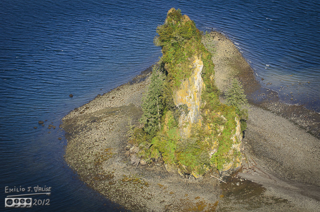 The cone rising above the rest of the island.