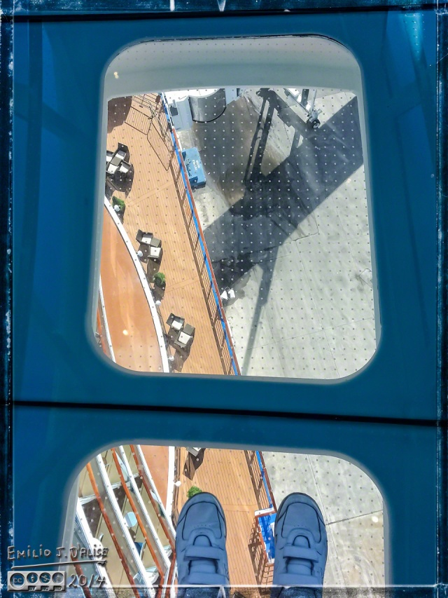 The glass walkway, showing the deck 9 decks below (one of the sitting areas)