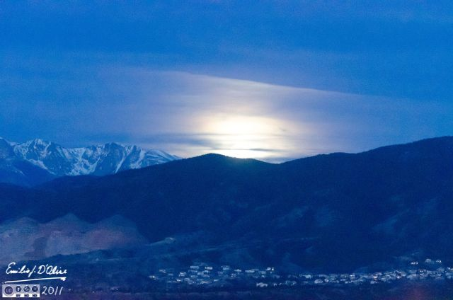 Moon setting behind Front Range with Pikes Peak to the side