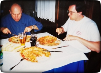 Margherita pizza was his favorite, often stacking two. Here enjoying it with Zio Marino.
