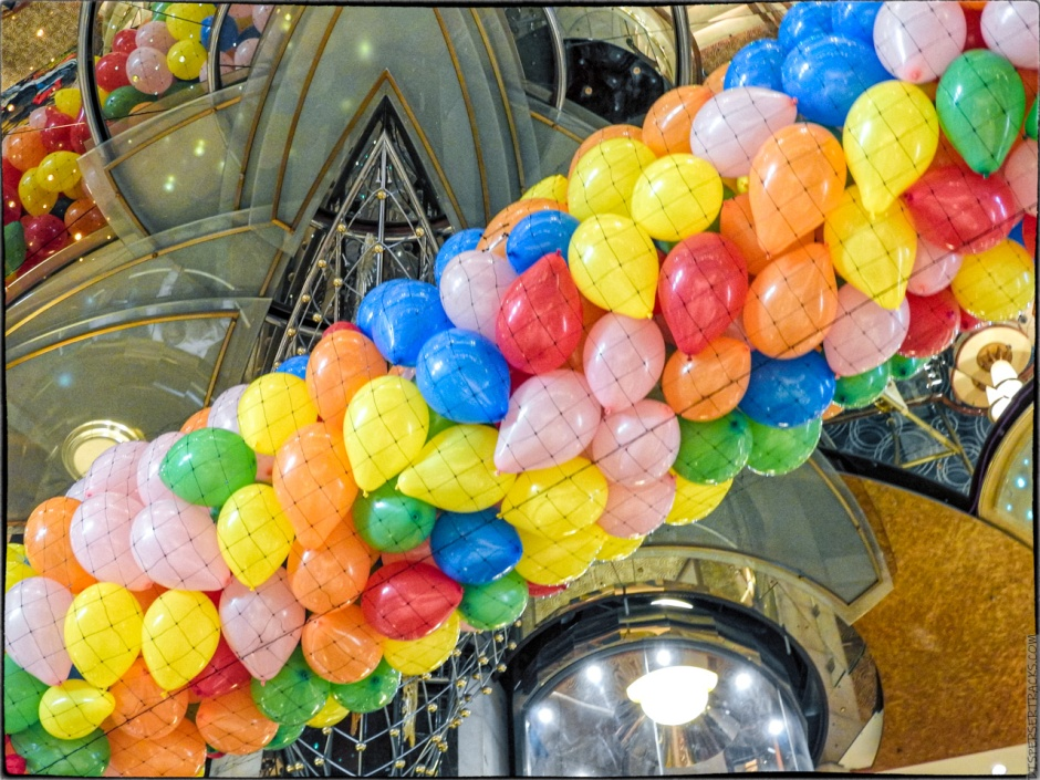 Balloons hanging from ceiling of cruise ship main atrium