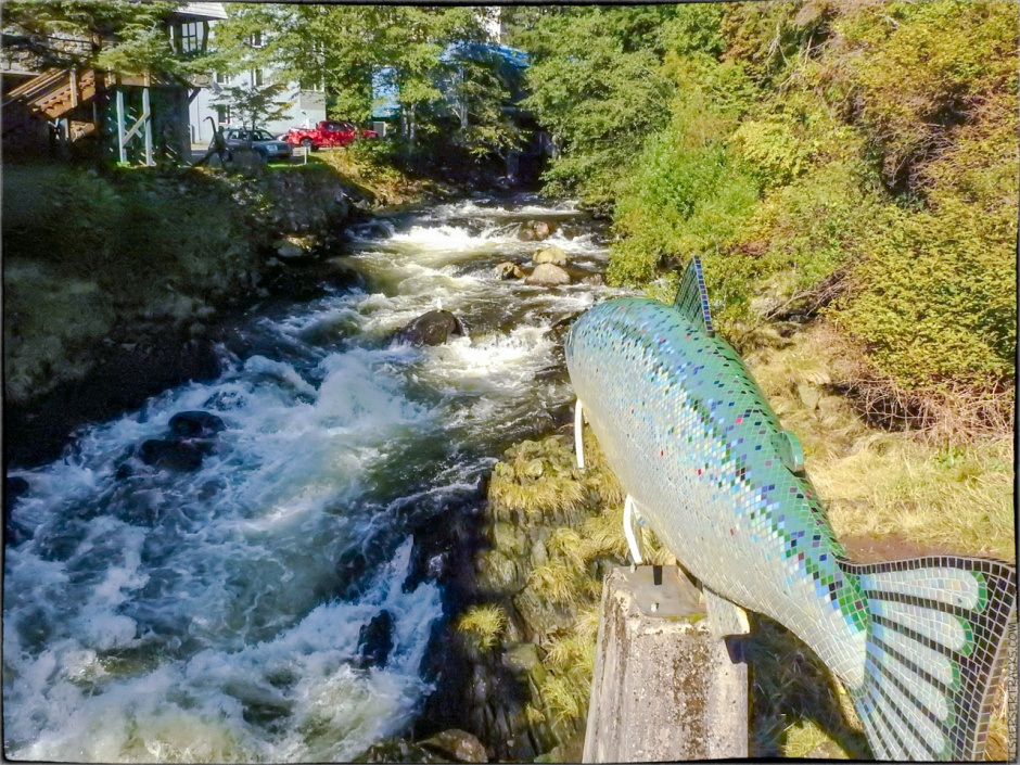 The statue pointing the way to the fish ladder in Ketchikan Creek