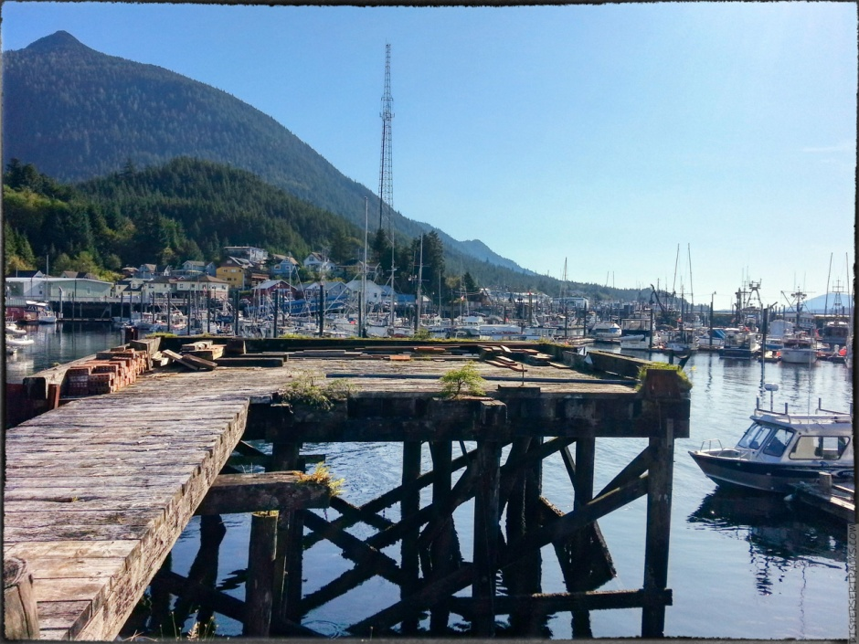A photo of boats in the Ketchikan marina and a small boardwalk