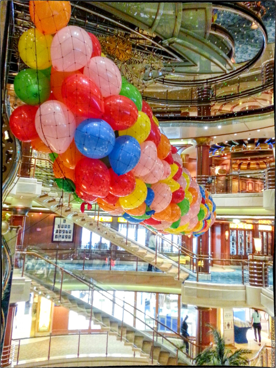 balloon net suspended from cruise ship's atrium ceiling