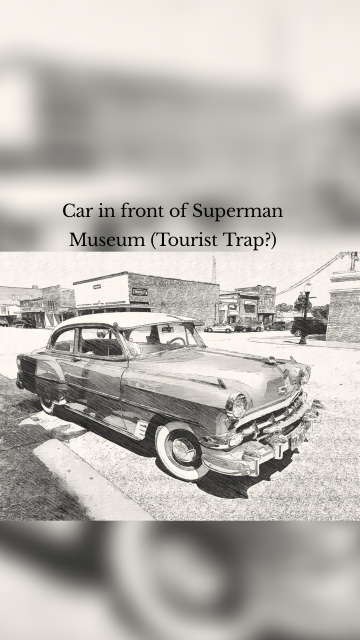 Car in front of Superman Museum (Tourist Trap?)